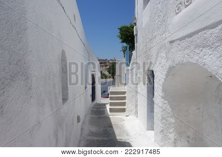 Summer day on a narrow street in Emporio, on the island of Santorini, in Greece