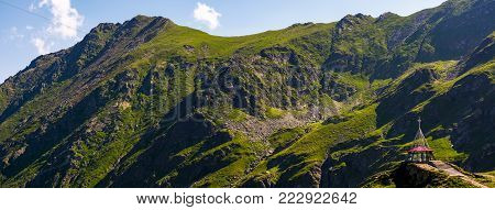 rocky mountain ridge with grassy slopes. lovely nature background