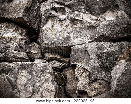 Closeup of large textured rocks, rock texture, rocks, boulders, grungy boulder texture
