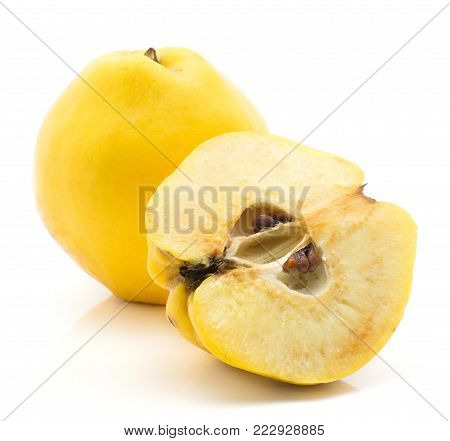 Yellow quince isolated on white background raw ripe one whole and one cross section half