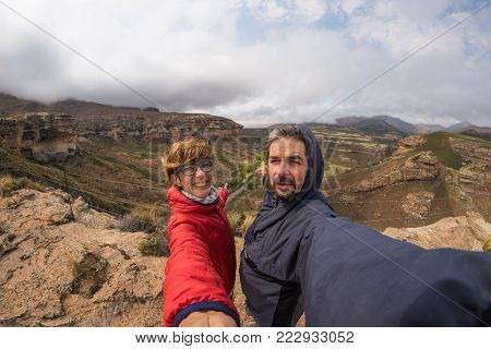 Couple selfie at Cape Point, Table Mountain National Park, scenic travel destination in South Africa. Fisheye view.