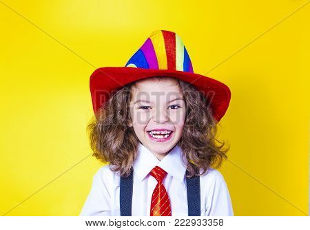 Portrait of a smiling little boy in a big American hat and shirt. Happy child.