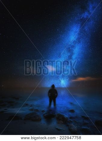 Strange Man (silhouette) Standing On Sea Shore And Watching Milky Way