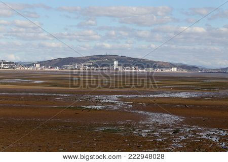 SWANSEA BAY, South Wales, UK - September 27, 2015: Swansea bay, seen here at low tide, is the proposed site for a controversial, pioneering tidal lagoon power-generation project.