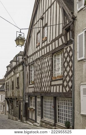 very old houses on a street in Chartres France