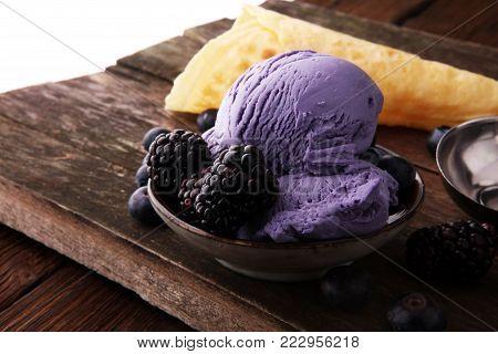Blackberry ice cream scoop, scooped with a ice spoon
