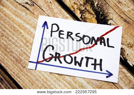 Personal growth - handwriting in a black ink on wooden background concept meaning personal development
