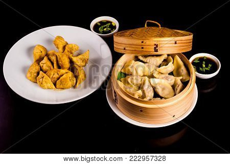 Yaki Gyoza. Japanese pan-fried dumplings in bamboo steamer