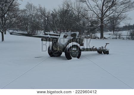 snow covered military army artillery gun cannon in winter
