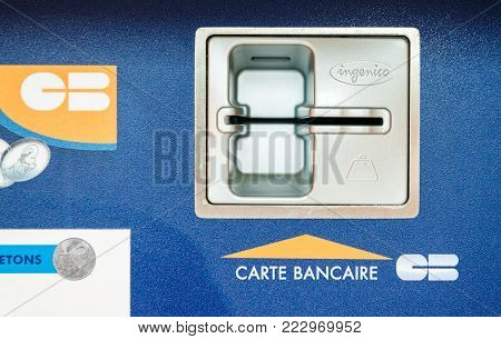 PARIS, FRANCE - SEPT 29, 2014: Insert credit car hole on the atm vending machine at specific electronic device
