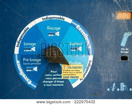 PARIS, FRANCE - SEPT 29, 2014: Car wash diverse setting for pressure water cleaner from pre-wash to wash, rinse, polish and special luxury setting - text in french at Elephant bleu