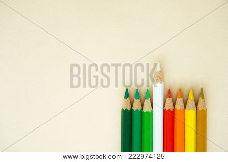 leader outstanding wood art white pencil color from group of red green yellow concept background