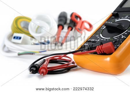 Multimeter and work tools and components for residential electrical installations, isolated on white background