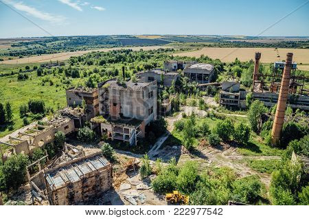 Aerial view to old abandoned industrial  buildings. Abandoned cement and reinforced concrete factory.