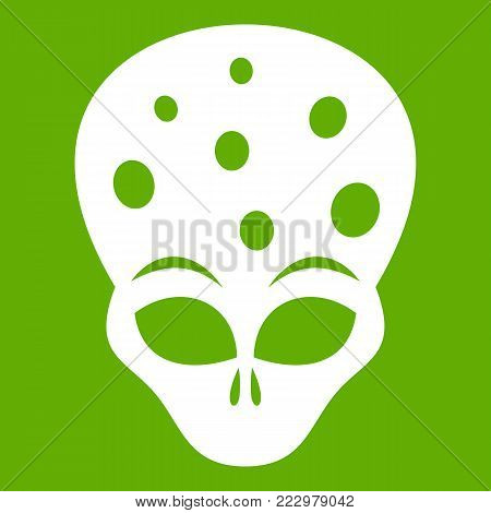 Extraterrestrial alien head icon white isolated on green background. Vector illustration