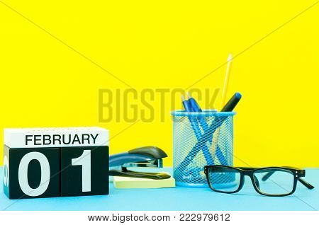 February 1st. Day 1 of february month, calendar on teacher or some manager workplace background. Winter time.