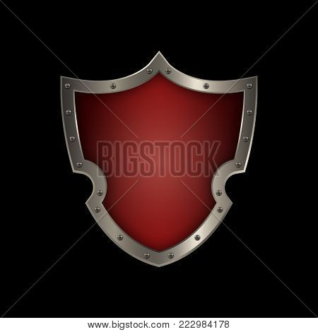 Red medieval shield with silver riveted border. Isolated on black background.