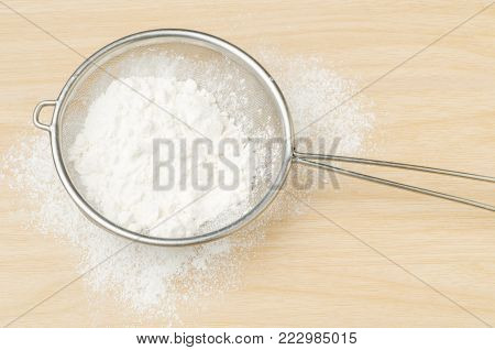 Flour in a sieve, food ingredient and recipe for bakery cooking