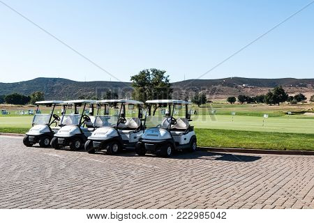 LAKESIDE, CALIFORNIA - JUNE 18, 2017:  A row of golf carts at Barona Creek Golf Club, an 18-hole course at the Barona Resort and Casino in San Diego, ranked as one of California's top courses.