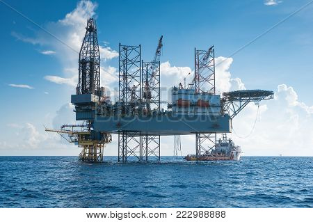Offshore oil and gas drilling rig working on new wellhead remote platform to completion on gas and crude oil well, oil and gas exploration and production