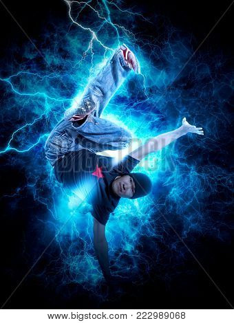 Young man break dancing on electricity light background