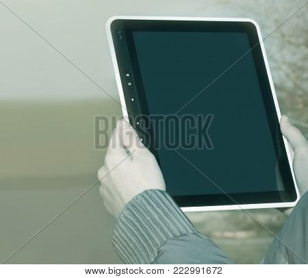 Close up hand woman holding tablet on isolated.photo with copy space.