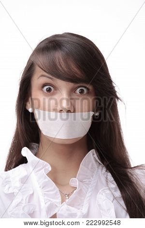 closeup.portrait of young business woman with taped mouth