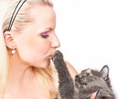 Beautiful young woman hugging and kissing cat poster