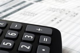 Pay slip and calculator, close up for payroll or salary background