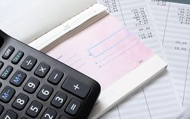 Euro check, Pay slip and calculator, close up for payroll or salary background, french mention Net to pay