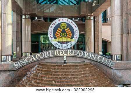Singapore - March 20, 2019: Closeup Of Sign Standing On Fountain At Entrance Of Singapore Recreation