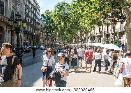 Barcelona; Spain - June 16, 2019: Street Caricaturist Painter Working At La Rambla Street. Las Rambl