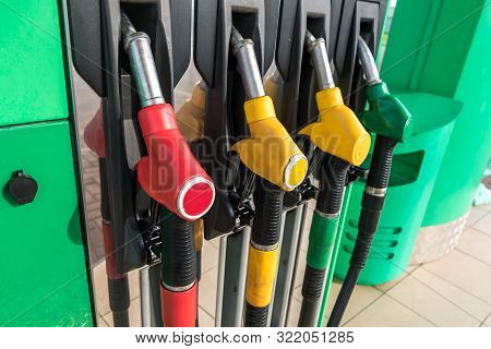 Gas And Petrol Station. Guns For Refueling At A Gas Station. Detail Of A Petrol Pump Different Color