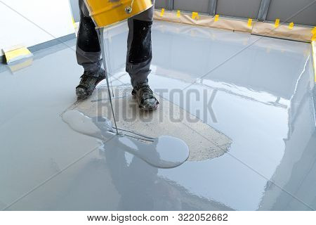 Construction Worker Renovates Balcony Floor And Pours Watertight Resin And Glue Before Chipping And