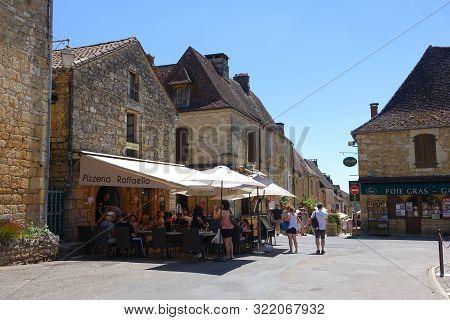 Domme, France 15 July 2019: A Restuarant Called Pizzeria Raffaello In The Town Square In The Bastide