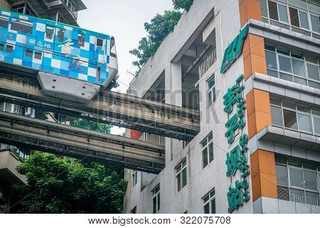 Chongqing China, 7 August 2019 : Close-up View Of Chongqing Metro Train About To Enter Liziba Statio