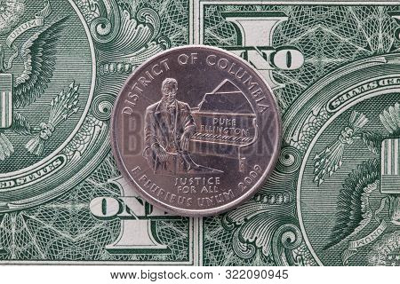 A Quarter Of District Of Columbia On Us Dollar Bills. Symmetric Composition Of Us Dollar Bills And A