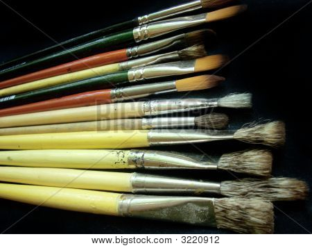 Artistic Brushes On A Dark Background