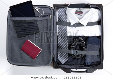 Business, Trip, Luggage And People Concept. Business Formal Wear Clothes Packed Into Travel Bag