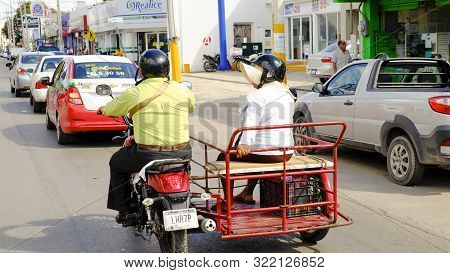 Tuxla, Chiapas, Mexico - January, 31st, 2018: Couple Driving A Motorcycle With Sidecar At A Busy Str