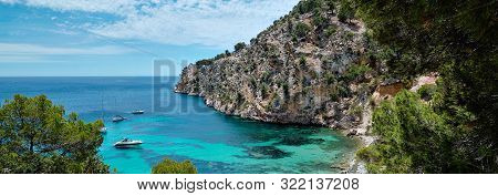 Panorama Of Moored Yachts In The Turquoise Bay Of Mediterranean Sea Located In Cala Blanca Andratx,
