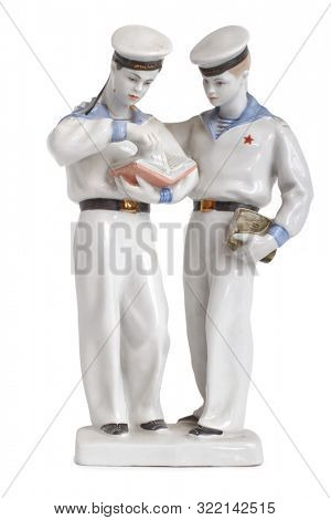 Antique porcelain figurine with sailors on a white background