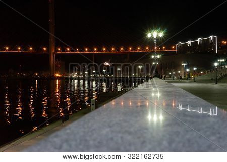 Vladivostok, Russia. Night Cityscape With Views Of The Waterfront Tsarevich.