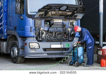 Mechanic Repairing Truck.  Engine Oil And Filter Change.