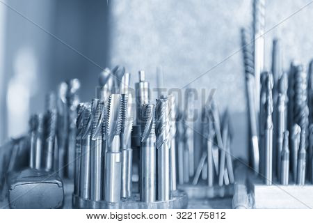 The Various Type  Cutting Tools Of Cnc Machine On The Stock Shelf  In The Light Blue Scene. The Coll