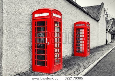 Classic British Old  red phone booth, monochrome image, UK
