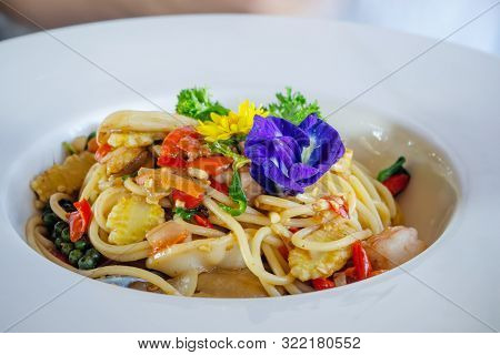 Stir Fried Spicy Spaghetti With Seafoods In White Dish