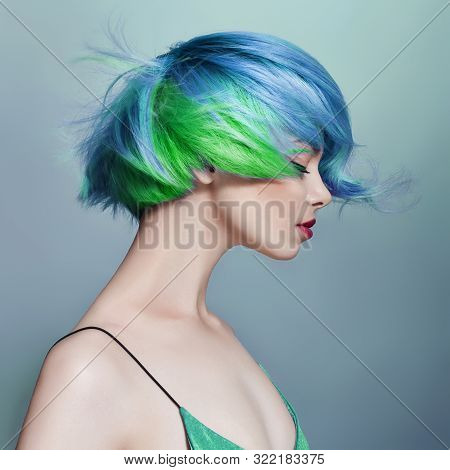 Portrait Of A Woman With Bright Colored Flying Hair, All Shades Of Blue Purple. Hair Coloring, Beaut