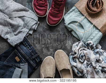 Women's Clothing On A Dark Background, Top View. Shopping Concept. Autumn Women's Clothing - Jeans,