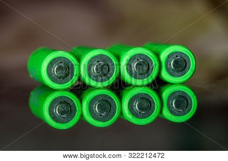 Close-up Of Green Alkaline Batteries. Close Up Colorful Rows Of Aa Batteries Energy Background Selec